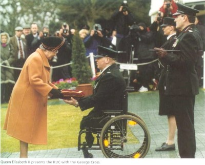 Queen Elizabeth II presents the RUC with the George Cross
